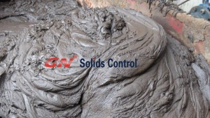 solids discharge from centrifuge